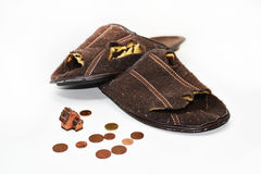 Leaky brown slippers. Stock Image