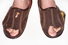 Leaky brown slippers. Royalty Free Stock Image