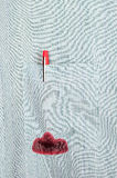 Leaky pen. A red ink pen leaks in the pocket of a dress shirt royalty free stock photography