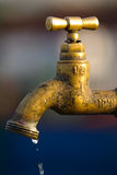 A leaky tap wasting water Royalty Free Stock Photos