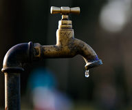 A leaky tap wasting water Royalty Free Stock Photography