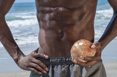 Lean abs and coconut Royalty Free Stock Photos