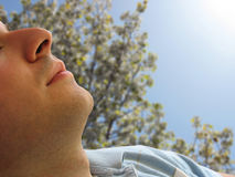 Lean back. Shot of a man that looks to be sleeping in the sun - includes clipping path.  Great image for skin cancer or harmful UV rays Royalty Free Stock Images