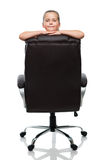 Lean on back of the armchair Royalty Free Stock Photography