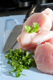 Lean chicken pieces with chopped parsley Stock Photography