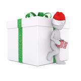 Lean on the christmas gift box. With christmas cap Royalty Free Stock Images