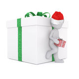 Lean on the christmas gift box. With christmas cap Royalty Free Stock Photo