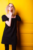 Lean girl posing on yellow background Stock Photography