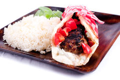 lean ground lamb gyro with rice and peas royalty free stock photo