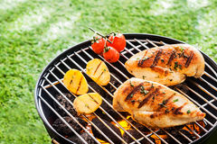 Lean healthy chicken breasts on a BBQ Stock Photos