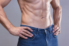 Lean male abs Royalty Free Stock Photo