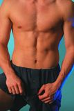 Lean male torso in blue 2 Stock Photo