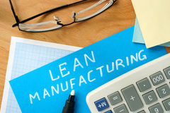 Lean manufacturing. Words lean manufacturing on the blue paper royalty free stock images