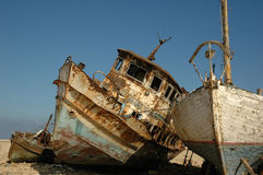 Lean on Me. Old boats Royalty Free Stock Photos