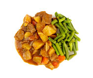 Lean meat cuisine appetite flavor. Culinary delight tempting  beef pot roast dinner with mashed potatoes beans vegetable gravy on white plate Royalty Free Stock Photo