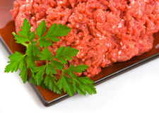 Lean Minced Steak. On plate isolated over white background Royalty Free Stock Photo