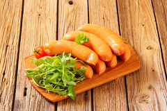 Lean smoked sausages. On cutting board Royalty Free Stock Images