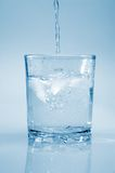 Сlean water and ice. Clean water to pour in glass Stock Image
