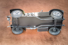 Leaned antique toy car Stock Photos