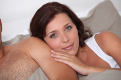 Leaning against her husband Stock Images
