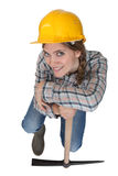 Leaning against her pickaxe Stock Image