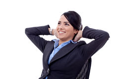 Leaning back in a black chair dreaming. Business woman leaning back in a black chair dreaming Royalty Free Stock Photo
