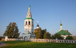 Leaning bell tower and two churches Stock Photo