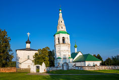 Leaning bell tower and two churches in the village of Kideksha. Stock Photography
