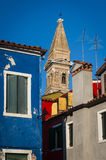 Leaning belltower and houses, Burano, Italy Stock Photos