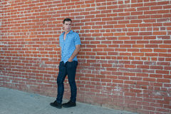 Leaning on the brick. Stock Image