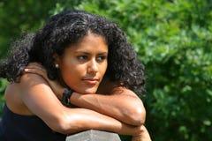 Leaning on the bridge railing. Beautiful brazilian woman leaning on the bridge Stock Image