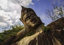 Leaning Buddha statue Royalty Free Stock Photo