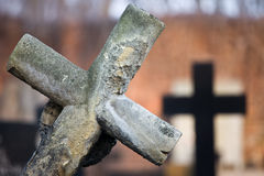 Leaning Cross at Cemetery Stock Photography