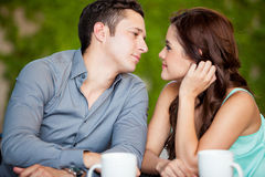 Leaning in for a kiss on a date Royalty Free Stock Photo