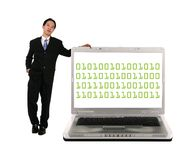 Leaning On Laptop With Binary Stock Image