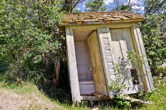 Leaning Outhouse Stock Images
