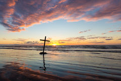 Leaning Over Cross Sunset Stock Photos
