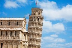 Leaning Pisa tower and part of cathedral Stock Photos