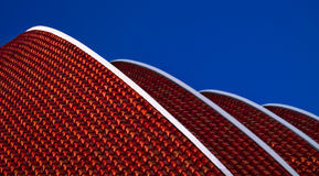 Leaning roof. Slanted red roof with a blue sky background Stock Photography