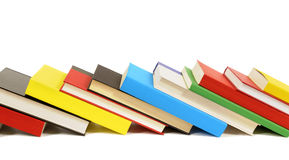 Leaning row of colorful books  on white background Royalty Free Stock Images
