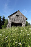 Leaning rustic old barn Stock Photo