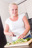 A stout woman in the kitchen Royalty Free Stock Images