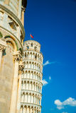Leaning tower behind the Baptistery, Pisa, Italy Royalty Free Stock Photo
