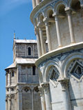 Leaning Tower and Cathedral of Pisa. Close-up view of the leaning tower and the cathedral of Pisa in the background with blue sky royalty free stock photos