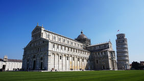 Leaning Tower and Cathedral of Santa Maria Assunta in Piazza dei Miracoli also known as Piazza del Duomo, Pisa, Italy Royalty Free Stock Images