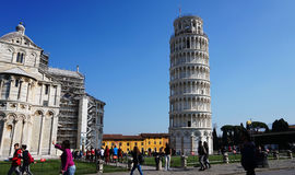 Leaning Tower and Cathedral of Santa Maria Assunta in Piazza dei Miracoli also known as Piazza del Duomo with tourists, Pisa, Ital Royalty Free Stock Photo