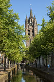 The leaning tower of the church the Oude Kerk, Delft Royalty Free Stock Image