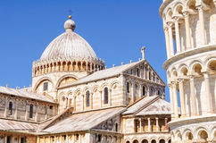 Leaning Tower and the Duomo - Pisa. Leaning Tower (Torre Pendente) and the Cathedral (Duomo) with the Greek Cross on its dome and the bronze Royalty Free Stock Photos