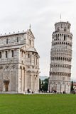 The Leaning Tower of Pisa. In front of the Cathedral all in marble with its columns Stock Images