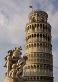 The Leaning Tower of Pisa. Statue in front of the Leaning Tower of Pisa Royalty Free Stock Images